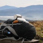 Luci Solar Lantern Charging on Backpack